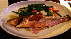 Spigola al Forno: Oven baked whole sea bass with garlic, cherry tomates, rosemary and white wine served with daily vegetales.